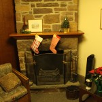 Sharon brought red-themed Christmas items from home to update the Fireside Room/Library for the holidays.