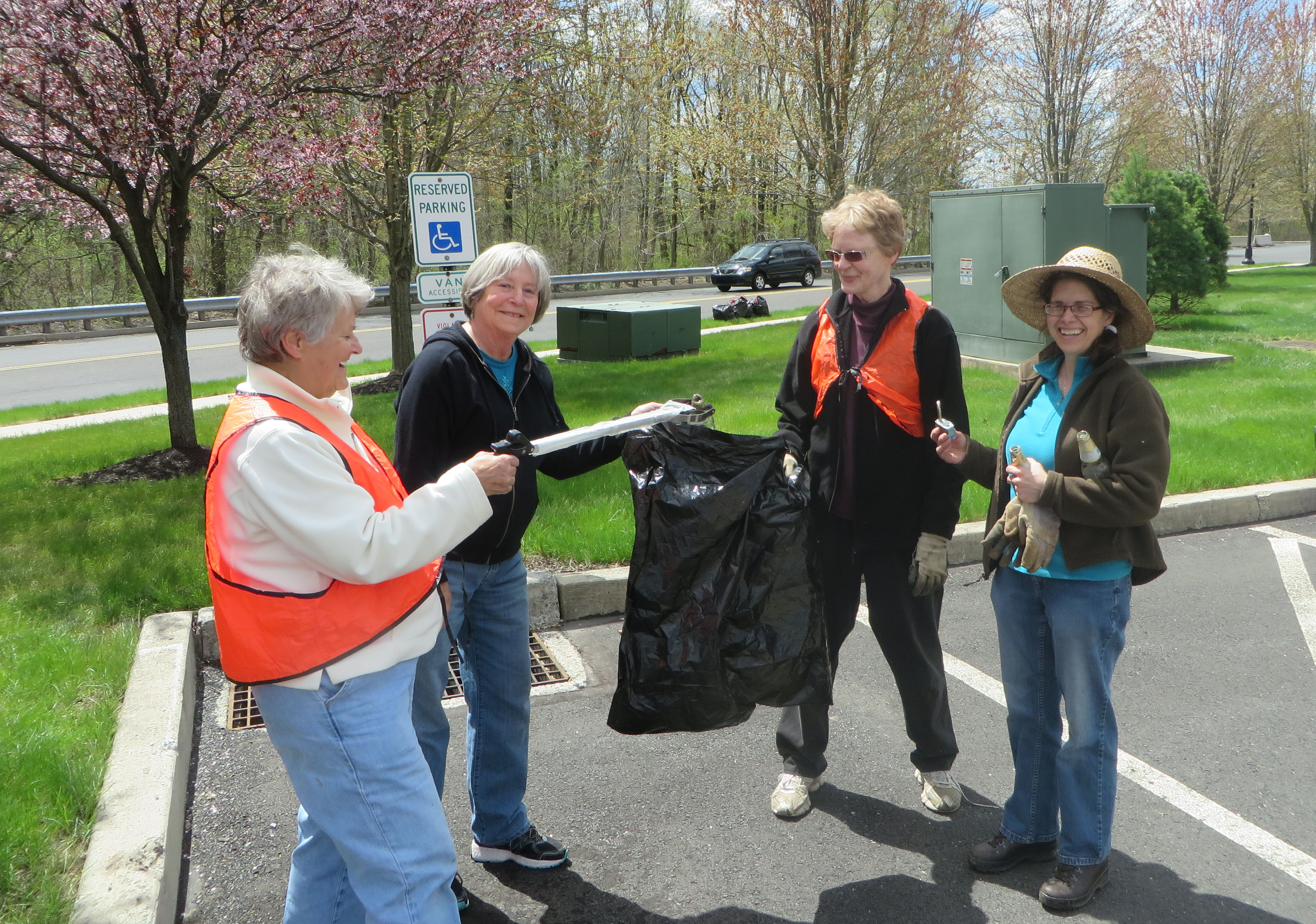 Ruth holds one of the quality grabbers loaned by Warrington Township for adopt-a-road trash pick-ups.